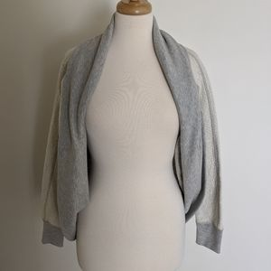 Textured knit shrug cardigan in cream and gray